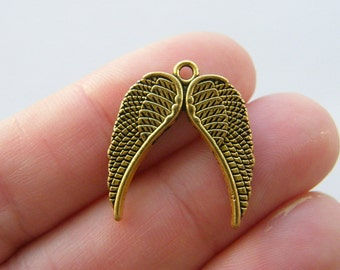 BULK 30 Angel wing  charms antique gold GC63