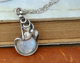 vintage find. antiqued sterling silver necklace with rainbow moonstone gemstone. oxidized silver necklace. leaf necklace.