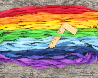 Handspun rainbow yarn, 58 yards and 3.25 ounces, 93 grams, spun self striping and thick and thin in hand dyed merino wool