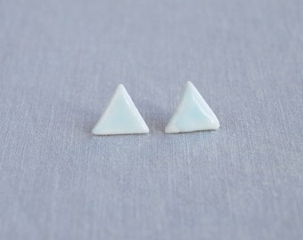 TRIANGLE stud earrings. White porcelain, celadon blue ceramic glaze, surgical steel posts, trending geometric jewellery