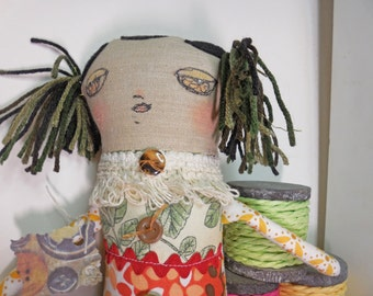 Woodland Girl a softsculpture doll with Fabric printed in Trees and Leaves