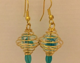Blue earrings in gold toned wire cage....free shipping