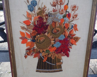 """Needlepoint vintage framed no glass flowers in a bucket flowers in orange, red, browns, blue green, yellow 19 1/2"""" tall by 15 1/2"""" across"""