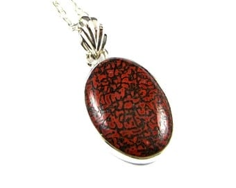 Superb Red Dinosaur Bone Sterling Silver Pendant - N900