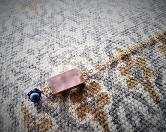Alta Marea collection glass collection. Rose quartz pendant with evil eye necklace.