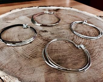 Multiple strand leather silver bracelet