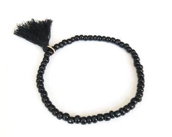 Beaded Tassel Yoga Bracelet, Small Black Seed Beads Stretch Minimal Stacking Festival Jewelry, Boho Bohemian, Simple Skinny Elastic Cord