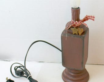 primitive looking electric wooden candle light lamp