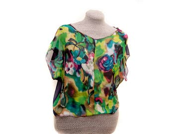 Womens green blouse made from abstract print chiffon fabric