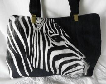 Black velvet bag with velvet zebra patch