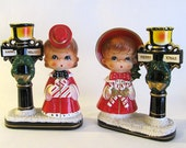 """Beautiful Tall Vintage Ceramic """"Merry Xmas, Happy Holiday"""" Candle Holder Pair- Girl Carolers, Lampposts, Japan- MINT"""