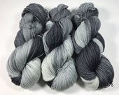 Coco Fingering, Hand Dyed Yarn, Fingering Weight, Superwash Merino, Ultra Soft Merino, Yarn, Hand Painted, 100g, on a grey streak