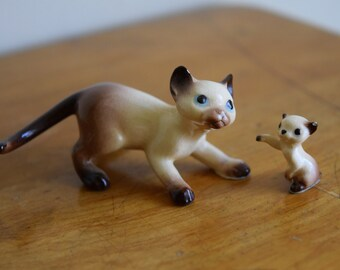Two vintage Hagen Renaker Siamese cat figurines