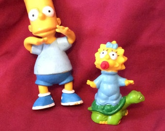 Bart and Maggie Simpson figures