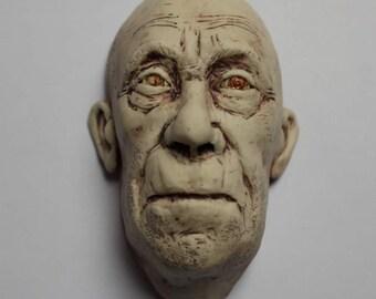 Man's Head in Porcelain Sculpture