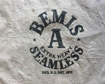 Double Sided Bemis/England via Liverpool typeset writing.