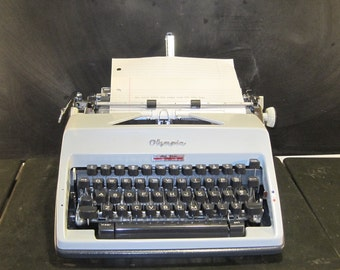 Vintage Olympia SM9 De Luxe Manual Portable Typewriter with Case