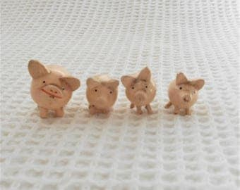 4 wooden pigs  Vintage Folk art Novelty Figures