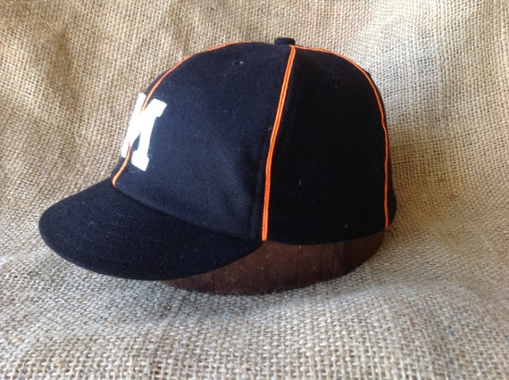 Black wool flannel cap with orange soutache and white felt M logo, Customize with any letter and cap size