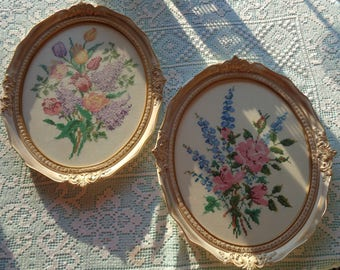 Two Large Oval Shape Hand Embroidered Floral Still Life Displays on White Linen fabric and framed & protected behind glass in Good Condition