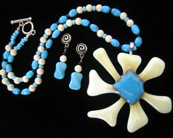 """Flower Power Artisan Necklace has 3"""" Glass Flower Pendant. Blue Art Glass Beads, Off White Stone Beads, Blue & Black Glass Spacers.  18.5"""" L"""
