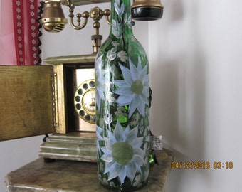 Green Wine bottle with large white and silver Dasies wild Flowers green leafes and white baby breath white lights inside