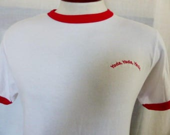 Yada, Yada, Yada vintage 90's Seinfeld T.V. Show solid white red ringer collar graphic t-shirt embroidered chest and sleeve logo medium