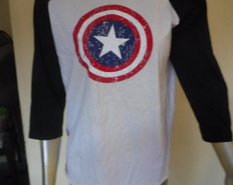 """25% OFF CLEARANCE SALE....3/4 sleeved captain america print design on white singlet ...42"""" to 46""""chest.."""