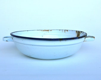 White enamelware bowl with handles
