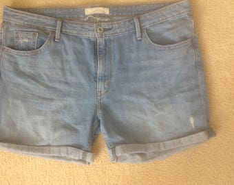 Levis high waisted distressed jean shorts size 14