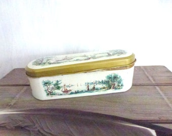 oval tin box with landscape