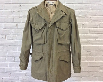 Vintage 1940s WWII US Army M-1943 Field Jacket worn by US Navy. Named, Size 38L