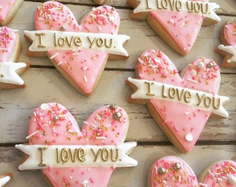 """Pink and Gold """"i love you"""" banner heart cookies"""