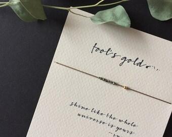 fool's gold reminder bracelets on black silk