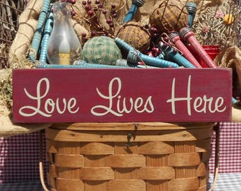 "Love Lives Here painted primitive farmhouse chic wood sign 4"" x 16"" choice of color"
