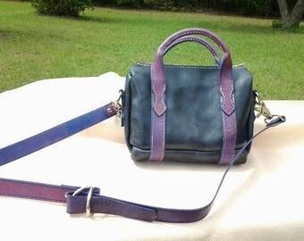 Purple and black leather handbag