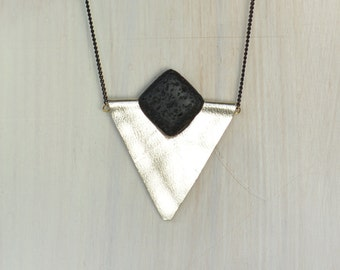 Bold triangle leather necklace.