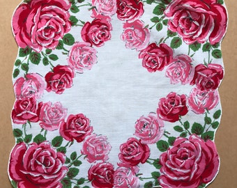 Five vintage ladies' hankies with red and pink roses graphics, 1950s-60s