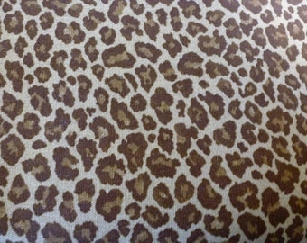 An upholstery weight leopard print by PKaufman - 57 1/2 inches wide x 7 yards.