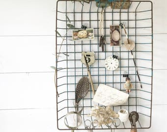 A vintage office wire IN and OUT basket desk tidy