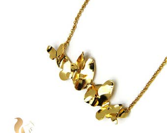 Macondo Necklace. Goldplated brass butterfly cluster necklace.