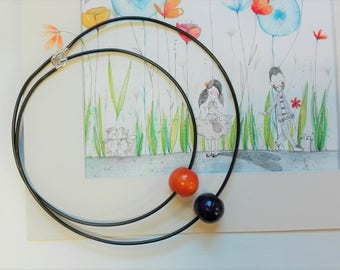 Wooden necklace cord with two wooden beads and painted in various colors