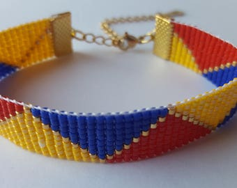Bracelet perles de verre Miyuki jaune, bleu et rouge tissées à la main. Ajustable