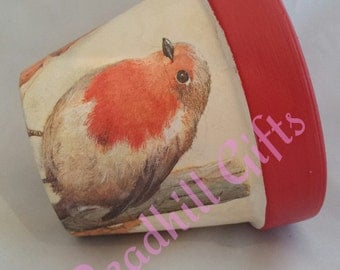 Hand decoupaged plant pot decorated with traditional red robins