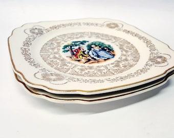 2 square porcelaine antiques plates with golden patterns romantic characters