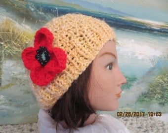 Unique knitted ladies spring hat in yellow, with a red poppy flower pin!