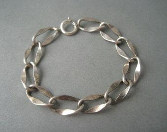 Tough elegant sterling silver bracelet, Sweden, year 1961.