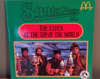 """Vintage 1985 McDonalds Edition """"Santa Claus The Movie"""" The Elves at the Top of the World Child's Collectible Storybook. Paperback with 23 pa"""