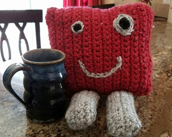 Handmade crocheted monster plush stuffed pillow.