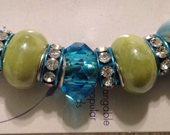 Darnice 9 piece Mix and Mingle Aqua Blue & Green Glass Metal Lined Beads....Interchangeable with Popular Brand Bracelets..... NEW